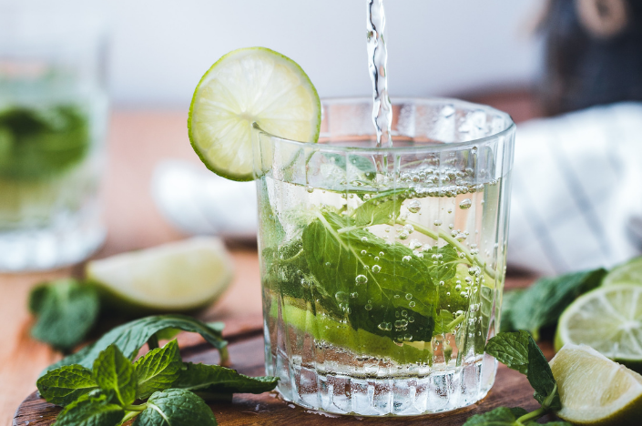 Making your own seltzer with mint and lime